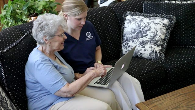 Caregiver Helping With Laptop Computer