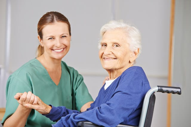 In-home nurse helping patient
